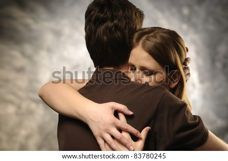 Couple in an embrace on an gray background