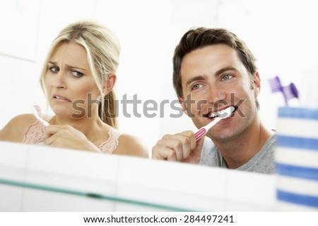 Couple In Bathroom Brushing Teeth - stock photo