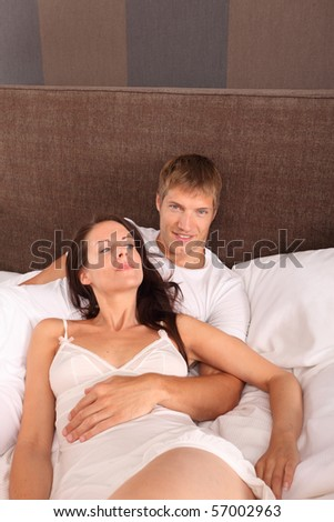 couple in bed - love - stock photo