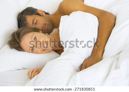 couple in bed smile - stock photo