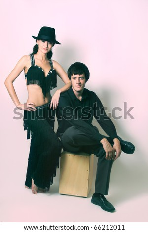 Couple in black dancers costume - stock photo