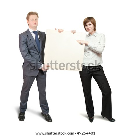 couple  in business outfit pointing at blank canvas, over white background - stock photo