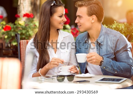 couple in cafe enjoying the time spending with each other - stock photo
