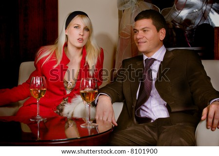 couple  in cafe, sitting with drinks - stock photo