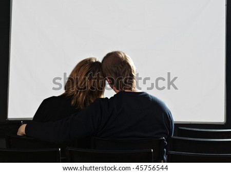 couple in cinema with white screen - stock photo