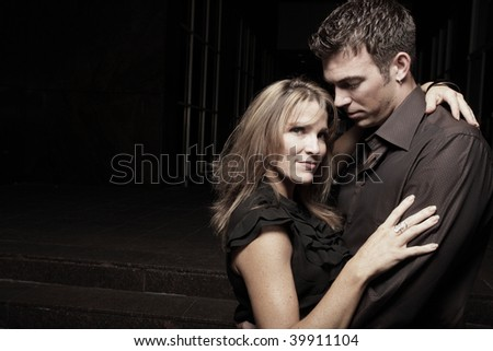 Couple in each others arms