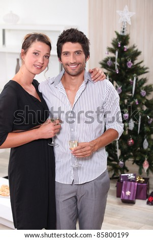 Couple in front of a Christmas tree - stock photo