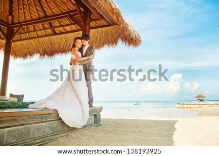 couple in gazebo on wedding day - stock photo