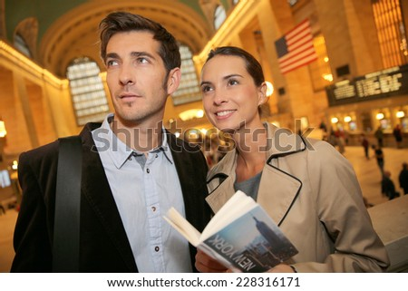 Couple in Grand Central station reading city guide