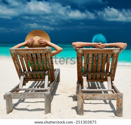 Couple in green on a tropical beach at Maldives - stock photo