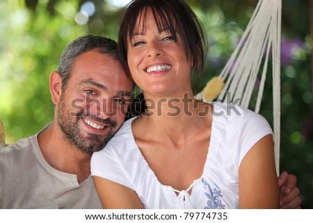 Couple in hammock - stock photo