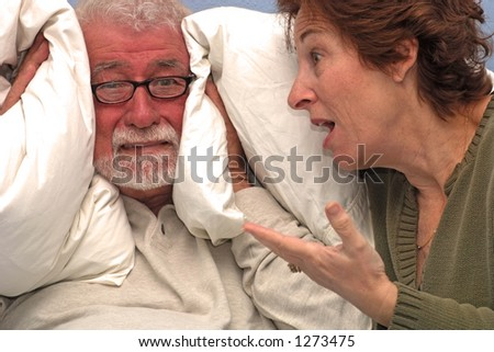Couple in heated talk, man has had enough! - stock photo