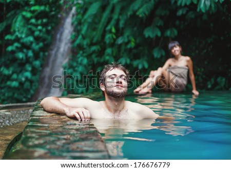 Couple in hot spring - stock photo