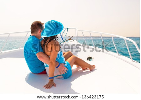 Couple in hug relaxing on the luxury yacht cruise - stock photo