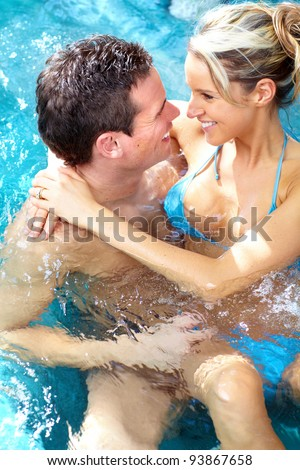 Couple in jacuzzi. Spa and relax. - stock photo