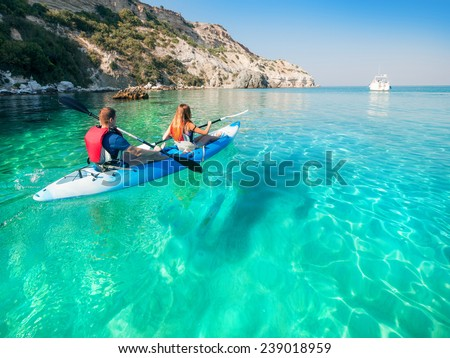 Couple in kayak on the sea. Water entertainment.