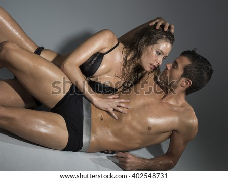 couple in lingerie having sex laying on the floor - stock photo
