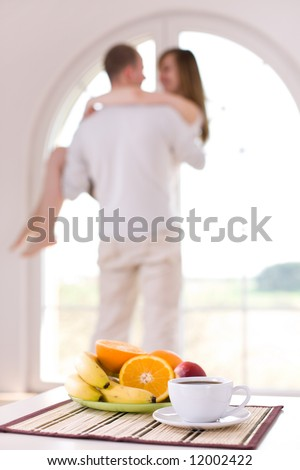 Couple in love at home / focus on the healthy breakfast - stock photo