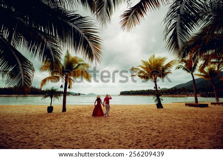 Couple in love at sunset. Beach. Palms. - stock photo