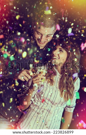 Couple in love at the New Year's party toasting each other - stock photo