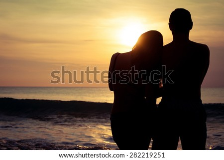 couple in love back light silhouette on sea at the  sunset time - stock photo