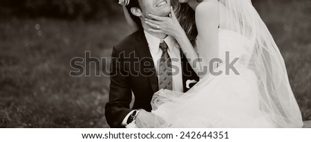 Couple in love bride and groom sitting together, having fun.  - stock photo