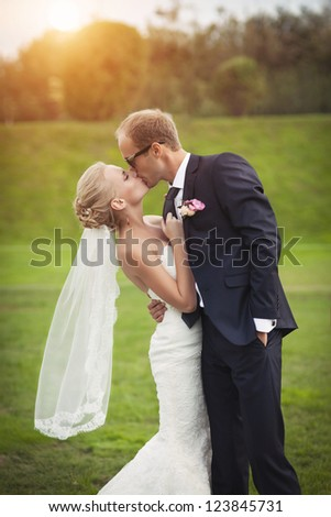 couple in love bride and groom together in wedding summer day enjoy a moment of happiness and love. Beautiful happy newlywed outdoors. handsome man and alluring woman in white dress on nature - stock photo