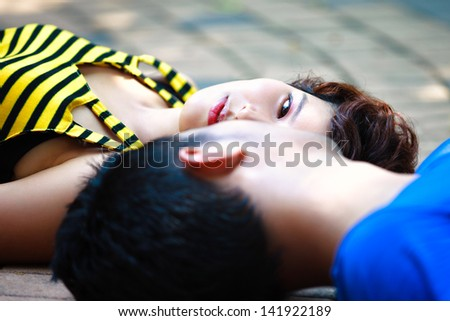 Couple in love, Closeup young asian couple laying on the floor - stock photo