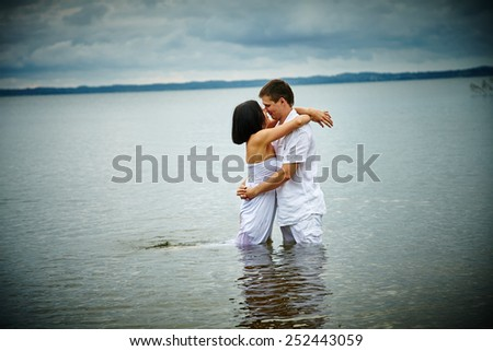 Couple in love. Couple near the water. Love. Summer love. Romance. - stock photo