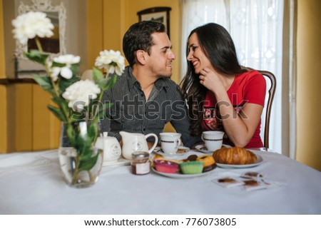 Couple in love drinking coffee in a bar