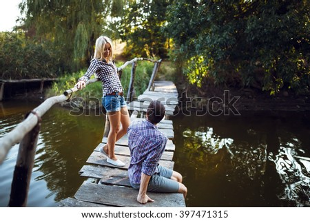 Couple in love enjoying tender moments during sunset . Emotional concept of relationship with travel boyfriend and girlfriends relaxing together - stock photo