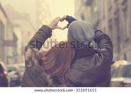 Couple in love.Focus on hands. - stock photo