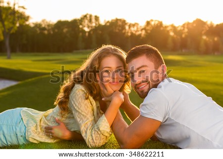 Couple in love. Happy eyes. Young people on nature. - stock photo