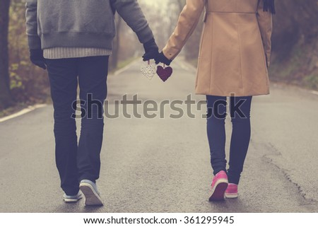 Couple in love holding hearts. - stock photo