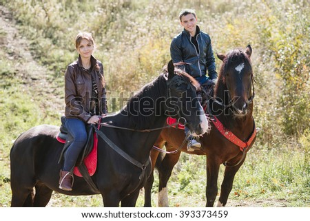 couple in love, horseback riding, tenderness, forest - stock photo