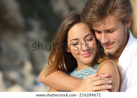 Couple in love hugging and feeling the romance with closed eyes outdoors           - stock photo