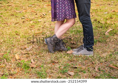 couple in love in park in fall - stock photo