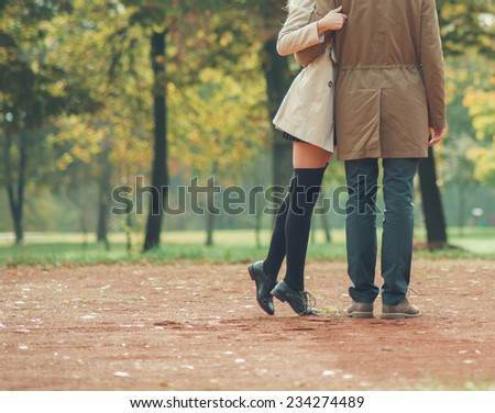 couple in love in park in spring - stock photo