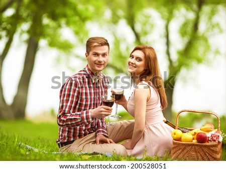 Couple in love in sitting near the river, picnic . Valentine's Day - stock photo