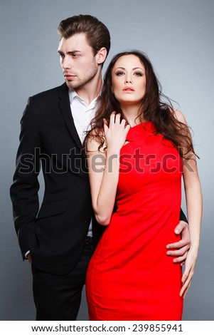 couple in love in studio, fashion, woman in red