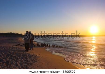 Couple in love in sunrise scenery - stock photo