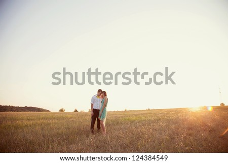 couple in love in the park at sunset - stock photo