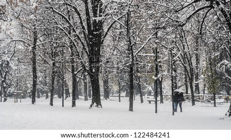 couple in love in winter snowy landscape with trees - stock photo