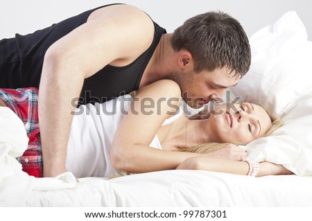 Couple in Love - man kissing sleeping woman - stock photo