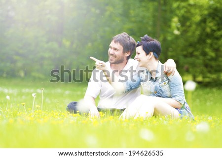 couple in love nature sitting, - stock photo