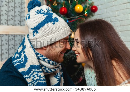 Couple in love near Christmas tree. New year. Christmas mood. - stock photo
