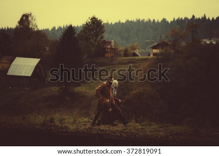Couple in love near yellow car in Karpathian mountains in cloudly weather - stock photo