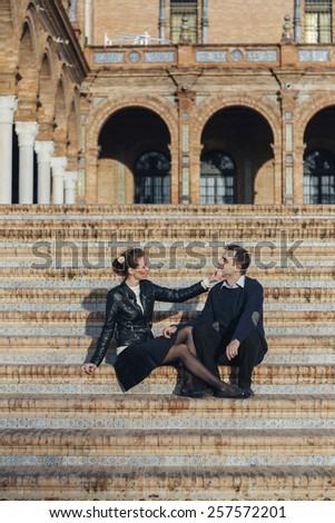 couple in love on Plaza de Espana Seville a popular tourist destination landmark. Romantic couple visiting Spanish tourists attractions sightseeing in Seville, Spain. - stock photo