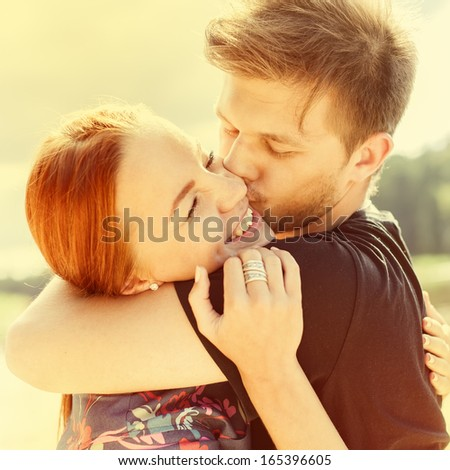 Couple in love on the beach on a sunny day - stock photo