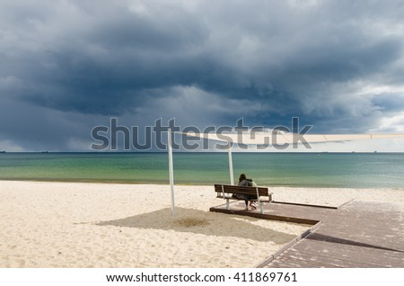 couple in love on the beach under umbrella
